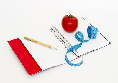 Notebook, tomato, ribbon and pen