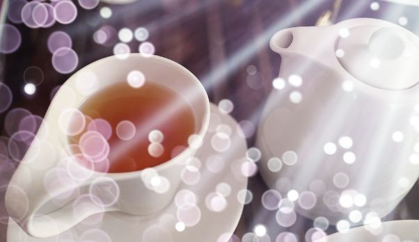 Cup of oolong tea and teapot