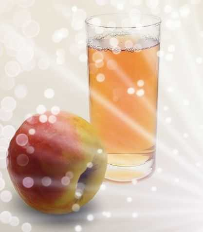 Apple and apple juice in a glass