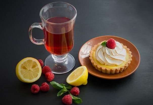 Cup of tea, cake, lemon and raspberry
