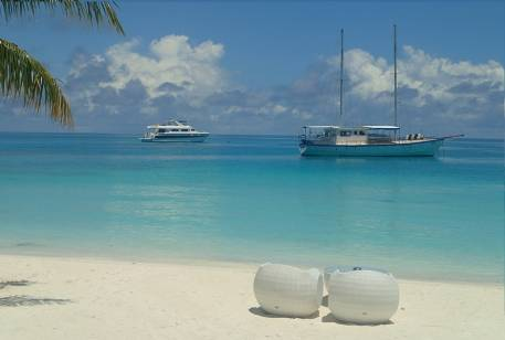 Maldives. Beach and two ships