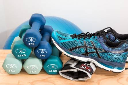 Colored dumbbells, ball and sneakers